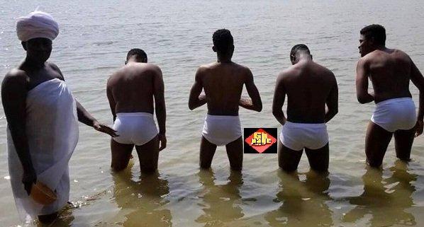 Akumaa Mama Zimbi Spotted Bathing 4 Naked Men In A River [Photos]