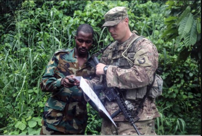 US Soldiers Enjoy Python Meat In Ghana(PHOTOS)