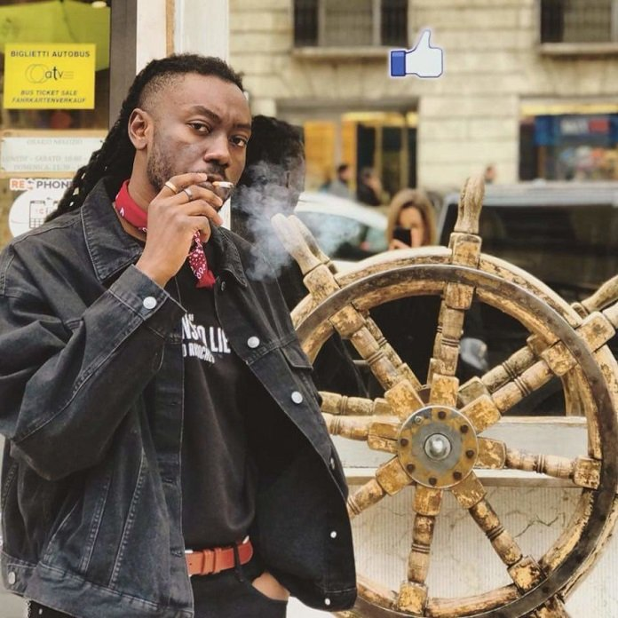Pappy Kojo Smoking in public 1 1 - I'm looking for a Ghanaian girlfriend who'll cook local foods – Pappy Kojo