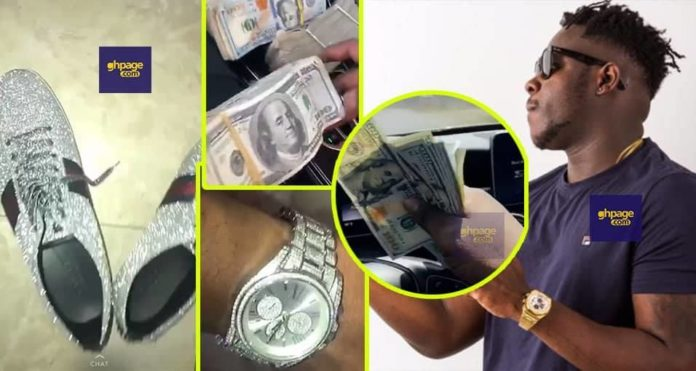 Medikal flaunts his cash and a customized diamond shoe