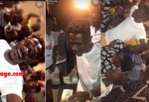 Shatta Wale gifts kids in his area with GHC10 each
