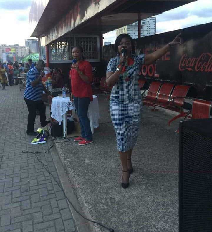 Mrs. Adwoa Asuama Abrefa preaching at a bus stop
