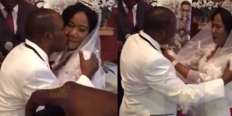 Bride pushes groom away as he tries to kiss the bride at the altar
