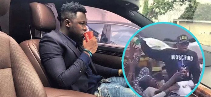 Medikal shares money and food to market women Nima