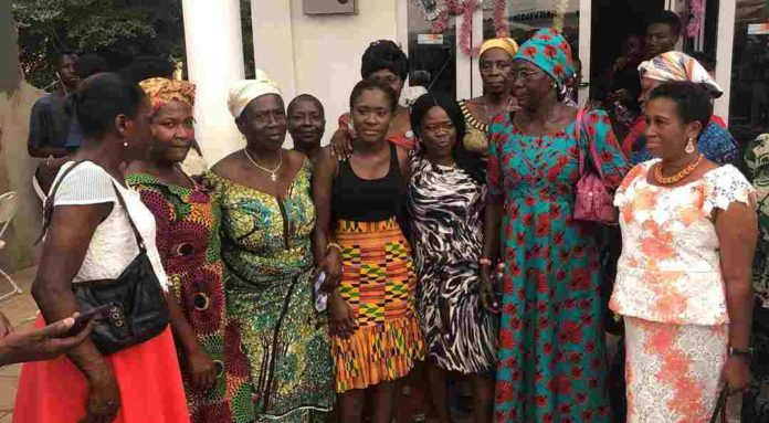 Fella Makafui in a photo with the widows she donated to