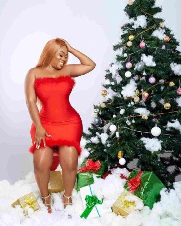 Moesha Boduong posing with Christmas tree