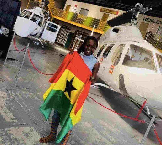 Pilot Maame Esi posing with Ghana flag