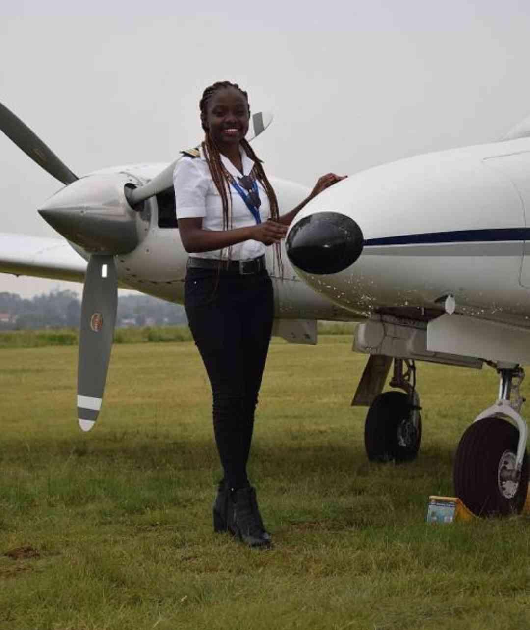 Pilot posing with aircraft