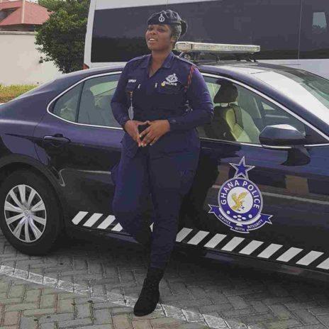 Yvonne Yaa Obrebea Appiah posing with a police car