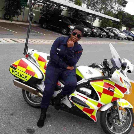 Yvonne Yaa Obrebea Appiah posing on a motor bike