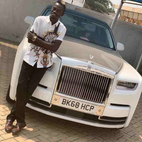 Nkansah Lilwin posing with the newly bought Rolls Royce