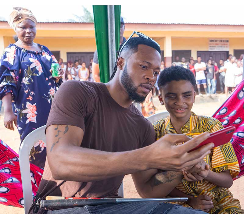 Flavour with his 'adopted' son Semah