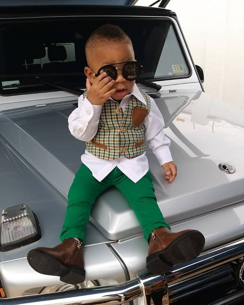 Obofour Jnr 1 - Rev Obofour's son swag up in style as he poses on his father's G-Wagon