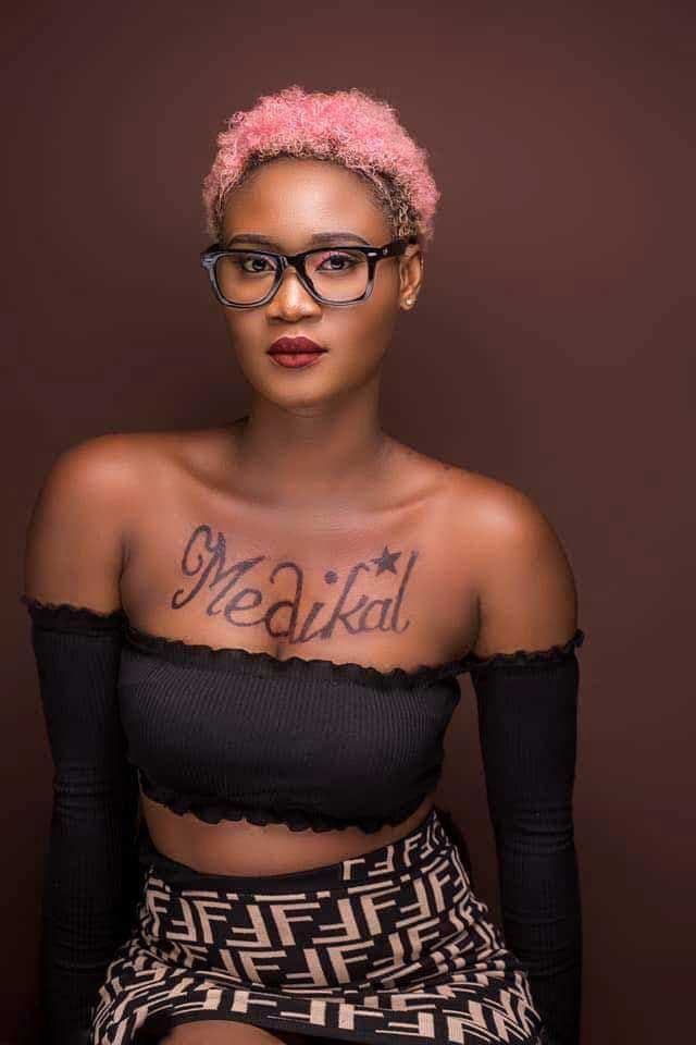 Queen Petrah - Desperate lady tattoos Medikal's name on her breast to gain his attention