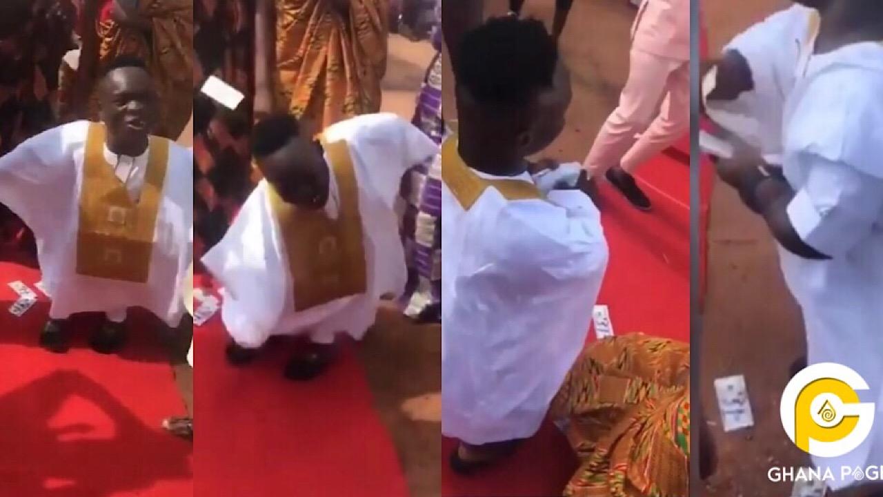 Shatta Bandle sprays wads of dollars at a wedding reception