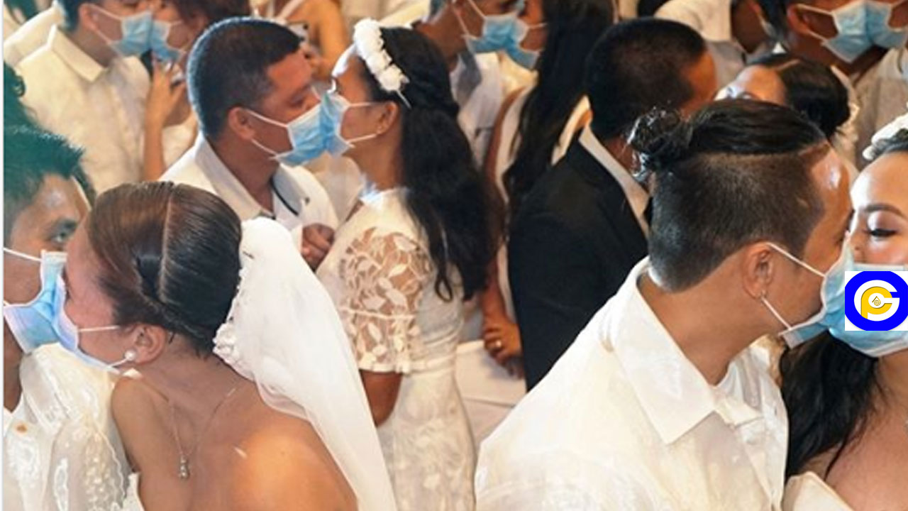 220 couples kiss while wearing face masks at mass wedding amid Coronavirus scare
