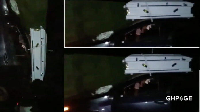 Young man caught carrying white coffin at dawn