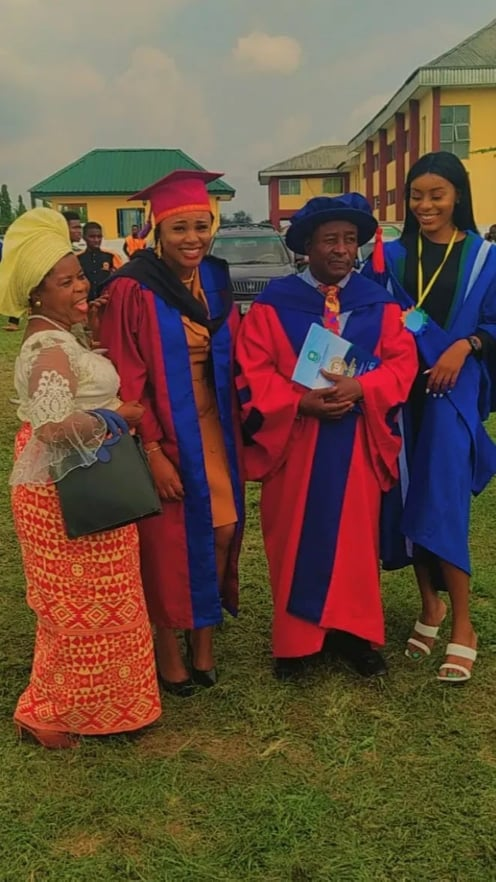 Man graduates with both daughters