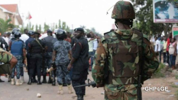 Police and the Military clash over a mobile phone in Juapong